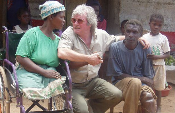 mike-with-landmine-victims-mozambique